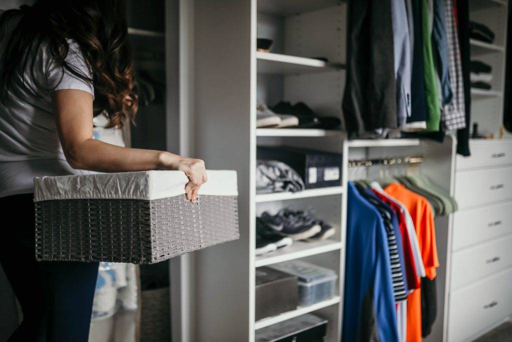 I like using storage boxes and baskets like these to utilize all of the extra space in every closet